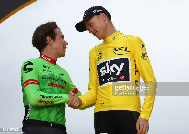 Chris Froome of Great Britain and Team Sky shakes hands with Rigoberto Uran of Columbia and Cannondale Drapac Professional Cycling Team following...