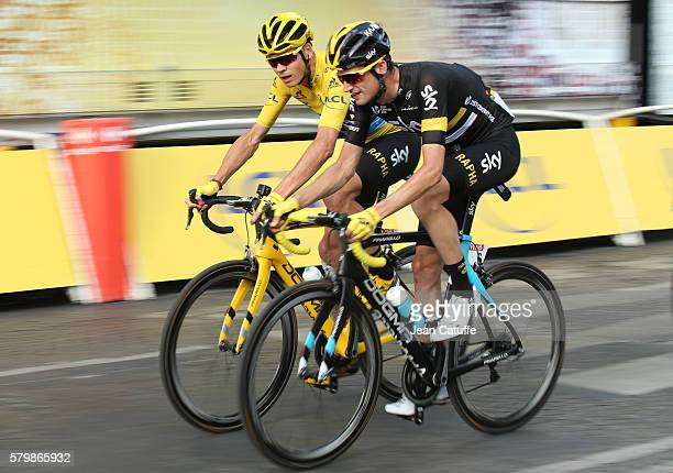 Chris Froome of Great Britain and Team Sky talks to teammate Wouter Poels of The Netherlands during stage 21 last stage of the Tour de France 2016...