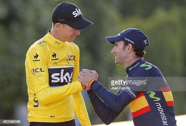 Chris Froome of Great Britain and Team Sky wearing the overall yellow jersey is congratulated by third place Alejandro Valverde of Spain and Movistar...