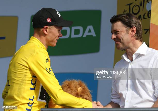 Chris Froome of Great Britain is congratulated by Mayor of Troyes Francois Baroin after retaining the yellow jersey following stage 6 of the Tour de...