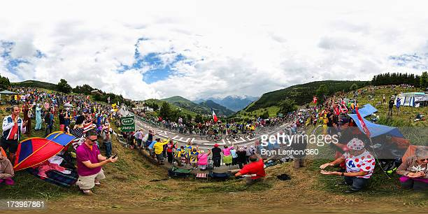 Chris Froome of Great Britain rides amongst the peloton on a climb during stage eighteen of the 2013 Tour de France a 1725KM road stage from Gap to...
