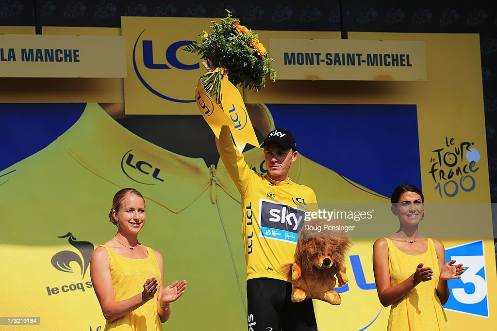 <a gi-track='captionPersonalityLinkClicked' href=/galleries/search?phrase=Chris+Froome&family=editorial&specificpeople=5428054 ng-click='$event.stopPropagation()'>Chris Froome</a> of Great Britain riding for Sky Procycling takes the podium after defending the overall race leader's yellow jersey during stage eleven of the 2013 Tour de France, a 33KM Individual Time Trial from Avranches to Mont-Saint-Michel, on July 10, 2013 in Mont-Saint-Michel, France.