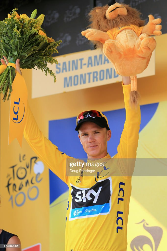 <a gi-track='captionPersonalityLinkClicked' href=/galleries/search?phrase=Chris+Froome&family=editorial&specificpeople=5428054 ng-click='$event.stopPropagation()'>Chris Froome</a> of Great Britain riding for Sky Procycling takes the podium after defending the overall race leader's yellow jersey during stage thirteen of the 2013 Tour de France, a 173KM road stage from Tours to Saint-Amand-Montrond on July 12, 2013 in Saint-Amand-Montrond, France.