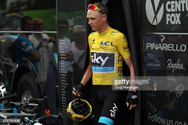 Chris Froome of Great Britain riding for Team Sky in the overall leader yellow jersey leaves the team bus as he prepares for stage four of the 2015...