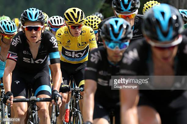 Chris Froome of Great Britain riding for Team Sky in the overall race leader yellow jersey rides in the protection of his teammates on the climb of...