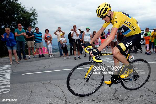 Chris Froome of Great Britain riding for Team Sky in the overall race leader yellow jersey makes the climb to the finish as he lost time to Nairo...