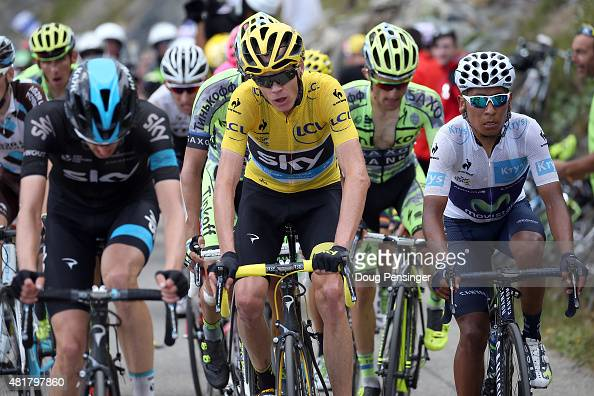 Chris Froome of Great Britain riding for Team Sky in the overall race leader yellow jersey rides with teammate Woeter Poels of the Netherlands riding...