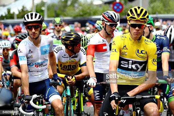 Chris Froome of Great Britain riding for Team Sky in the yellow leaders jersey and Adam Yates of Great Britain riding for OricaBikeExchange the...