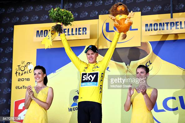 Chris Froome of Great Britain riding for Team Sky retains the yellow leaders jersey on the podium after completing stage eleven of the 2016 Le Tour...