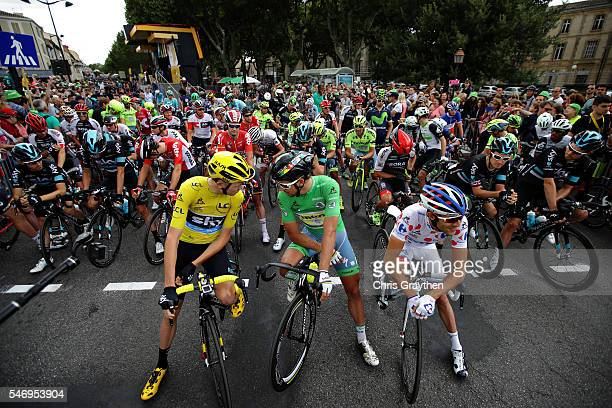 Chris Froome of Great Britain riding for Team Sky wearing the yellow leaders jersey and Peter Sagan of Slovakia riding for Tinkoff wearing the green...