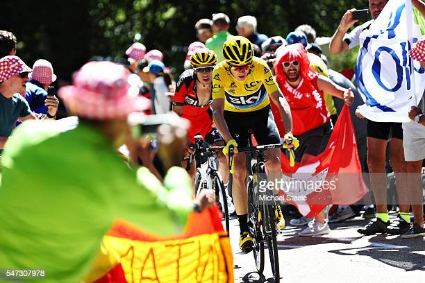 Chris Froome of Great Britain riding for Team Sky wearing the yellow leaders jersey attacks on Mont Ventoux with Richie Porte of Australia riding for...