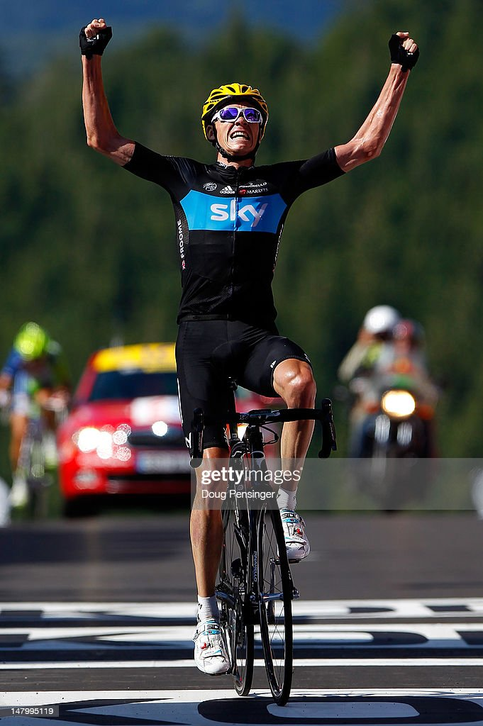 Chris Froome of Great Britian riding for Sky Procycling celebrates as he crosses the finish line to win stage seven of the 2012 Tour de France from...