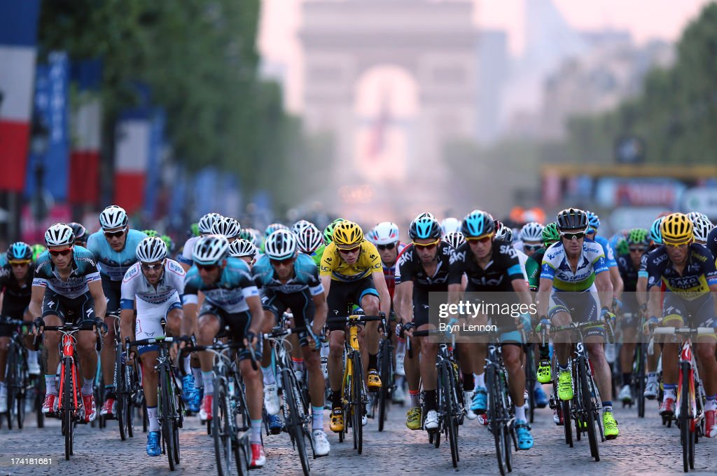 <a gi-track='captionPersonalityLinkClicked' href=/galleries/search?phrase=Chris+Froome&family=editorial&specificpeople=5428054 ng-click='$event.stopPropagation()'>Chris Froome</a> (C) of SKY Procycling rides in the bunch during the twenty first and final stage of the 2013 Tour de France, a processional 133.5KM road stage ending in an evening race around the Champs-Elysees, on July 21, 2013 in Paris, France.