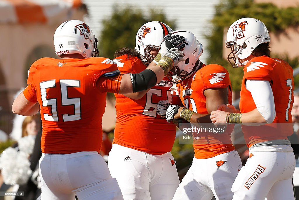 Chris Gallon #81 of the Bowling Green Falcons is congratulated after scoring a touchdown against the Kent State Golden Flashes during the second quarter on November 17, 2012 at Doyt Perry Stadium in Bowling Green, Ohio.