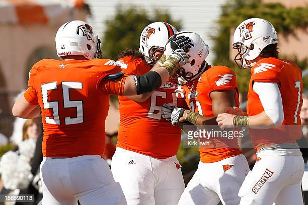 Chris Gallon of the Bowling Green Falcons is congratulated after scoring a touchdown against the Kent State Golden Flashes during the second quarter...