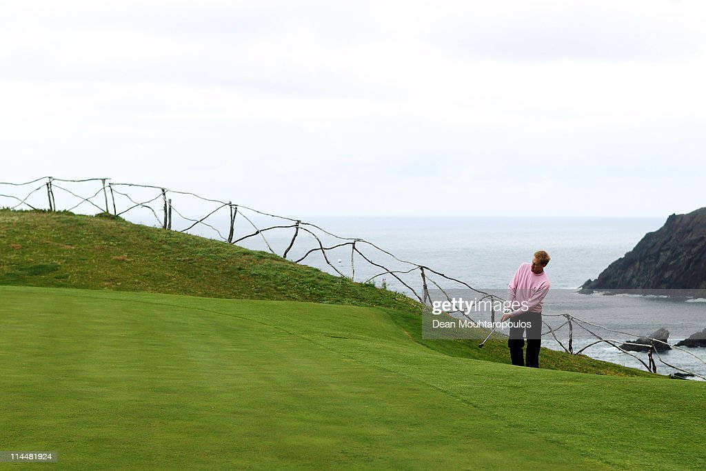 <a gi-track='captionPersonalityLinkClicked' href=/galleries/search?phrase=Chris+Gane&family=editorial&specificpeople=565959 ng-click='$event.stopPropagation()'>Chris Gane</a> of England hits his second shot on the 13th hole during day three of the Madeira Islands Open on May 21, 2011 in Porto Santo Island, Portugal.