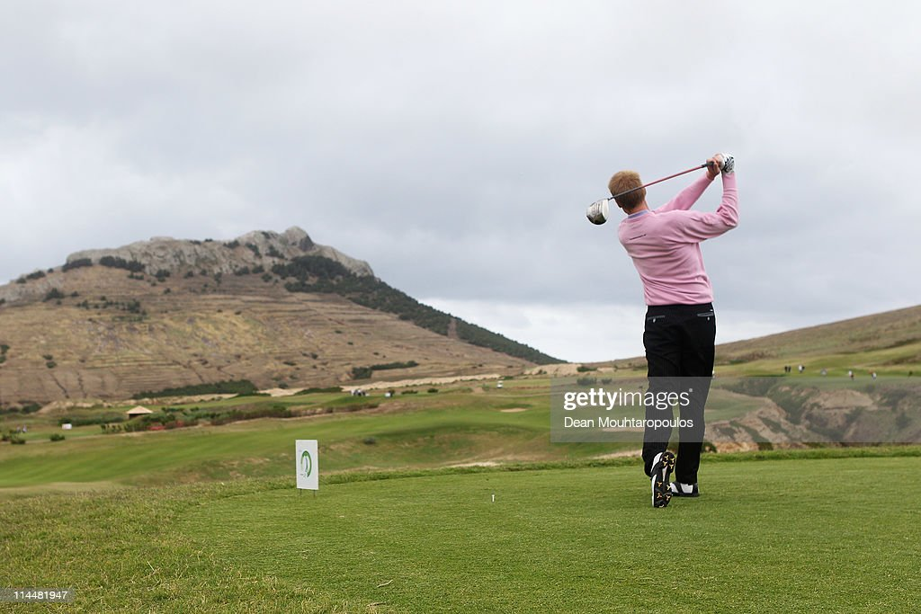 <a gi-track='captionPersonalityLinkClicked' href=/galleries/search?phrase=Chris+Gane&family=editorial&specificpeople=565959 ng-click='$event.stopPropagation()'>Chris Gane</a> of England hits his tee shot on the 14th hole during day three of the Madeira Islands Open on May 21, 2011 in Porto Santo Island, Portugal.