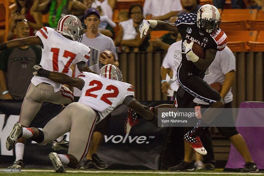Chris Gant #81 of the Hawaii Warriors carries the ball against David Greene #22 and Kenneth Penny #17 of the UNLV Rebels the during a NCAA college football game between the UNLV Rebels and the Hawaii Warriors on November 24, 2012 at Aloha Stadium in Honolulu, Hawaii.