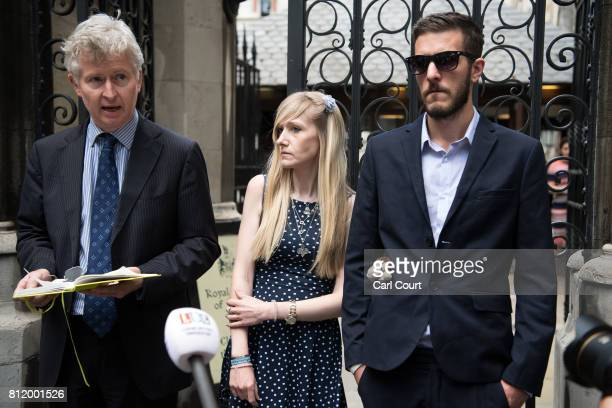 Chris Gard and Connie Yates the parents of terminally ill toddler Charlie Gard listen as family friend Alasdair SetonMarsden addresses the media...