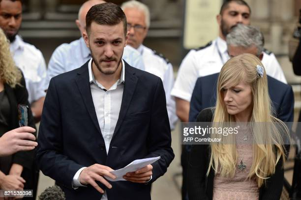 TOPSHOT Chris Gard the father of terminallyill 11monthold Charlie Gard reads out a statement while Charlie's mother Connie Yates looks on at the...