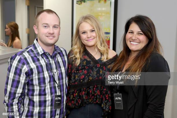 Chris Gaulke Hailey Whitters and Kerri FoxMetoyer attend APA Nashville's open house at One Nashville Place on June 6 2017 in Nashville Tennessee