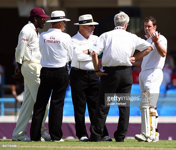 Chris Gayle and Andrew Strauss discuss with match officials the state of the pitch before the abandonment of day one of the 2nd Test between The West...
