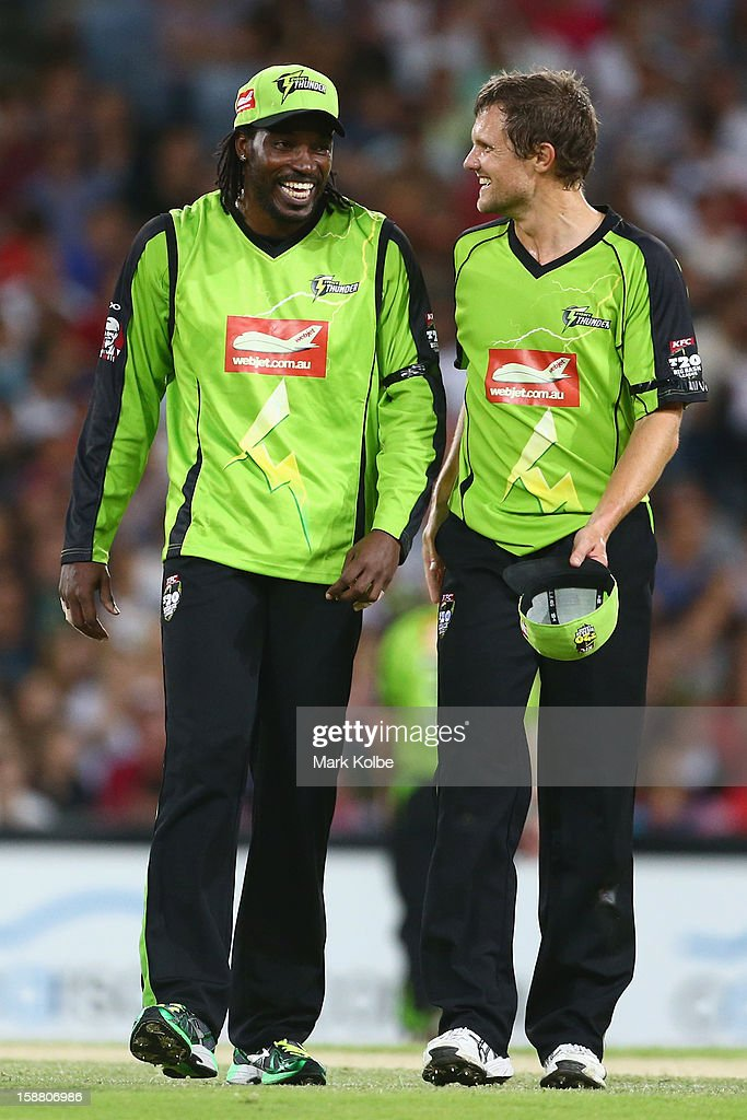 Chris Gayle and Dirk Nannes of the Thunder share a laugh after combining to remove Nic Maddinson of the Sixers share a laugh during the Big Bash League match between Sydney Thunder and the Sydney Sixers at ANZ Stadium on December 30, 2012 in Sydney, Australia.