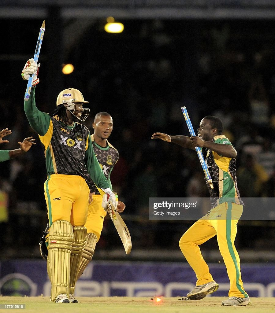 <a gi-track='captionPersonalityLinkClicked' href=/galleries/search?phrase=Chris+Gayle+-+Cricket+Player&family=editorial&specificpeople=206191 ng-click='$event.stopPropagation()'>Chris Gayle</a> (L), Dave Bernard Jnr. (C) and Chadwick Walton (R) of Jamaica Tallawahs celebrating victory against Guyana Amazon Warriors during the Final of the Caribbean Premier League between Guyana Amazon Warriors v Jamaica Tallawahs at Queens Park Oval on August 24, 2013 in Port of Spain, Trinidad and Tobago.