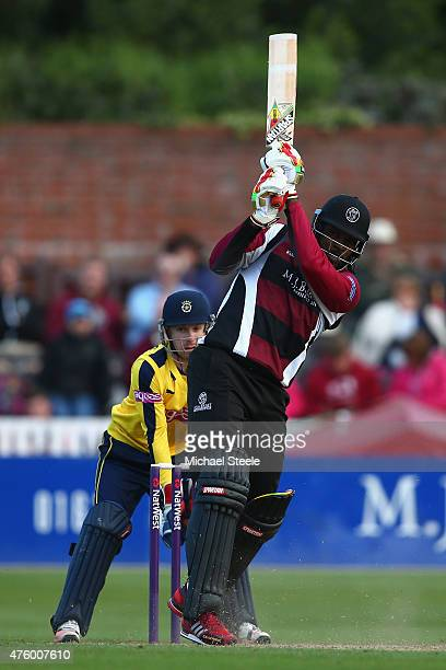 Chris Gayle of Somerset hits to the legside as wicketkeeper Adam Wheater of Hampshire looks on during the NatWest T20 Blast match between Somerset...