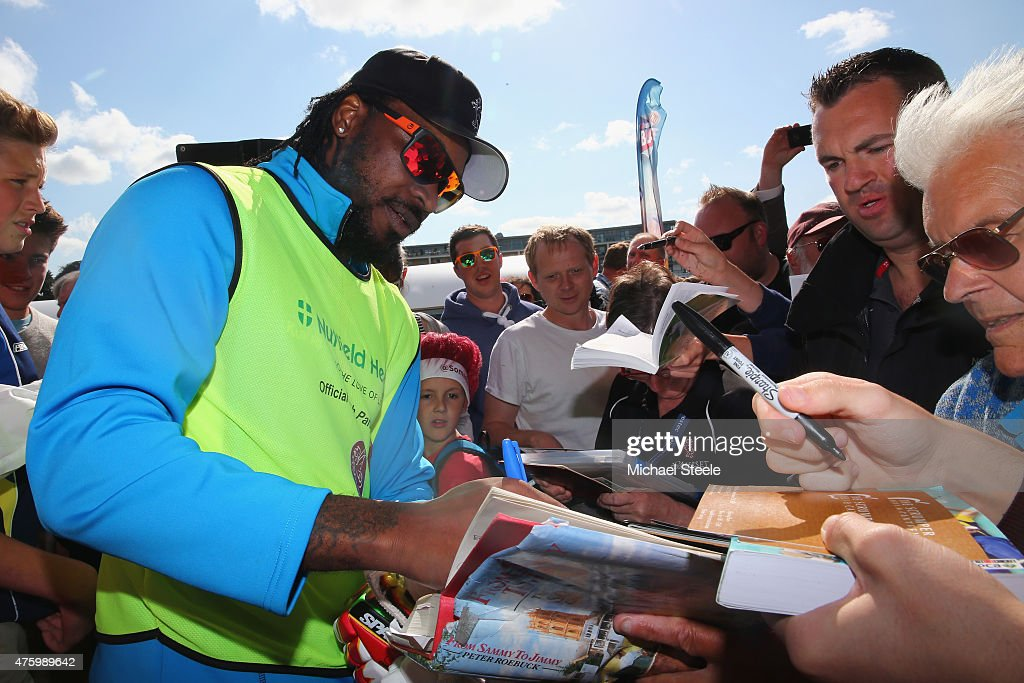 Chris Gayle of Somerset signs autographs during the NatWest T20 Blast match between Somerset and Hampshire at The County Ground on June 5 2015 in...