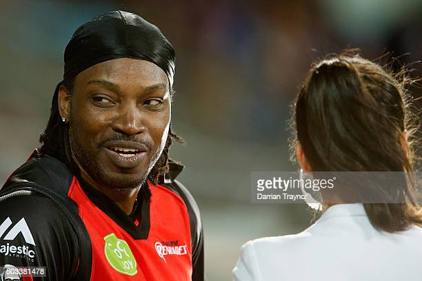 Chris Gayle of the Melbourne Renegades gives a TV interview to Mel Mclaughlin during the Big Bash League match between the Hobart Hurricanes and the...