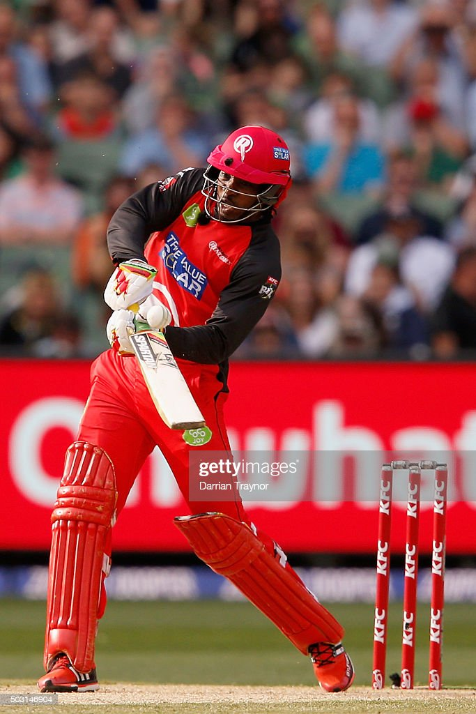 <a gi-track='captionPersonalityLinkClicked' href=/galleries/search?phrase=Chris+Gayle+-+Cricket+Player&family=editorial&specificpeople=206191 ng-click='$event.stopPropagation()'>Chris Gayle</a> of the Melbourne Renegades hits a ball off the bowling of John Hastings of the Melbourne Stars during the Big Bash League match between the Melbourne Stars and the Melbourne Renegades at Melbourne Cricket Ground on January 2, 2016 in Melbourne, Australia.