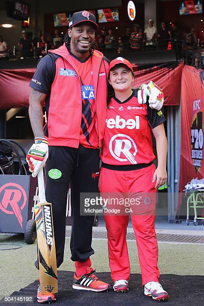 Chris Gayle of the Renegades hugs Jenny Taffs of the Renegades during the Big Bash League match between the Melbourne Renegades and the Melbourne...