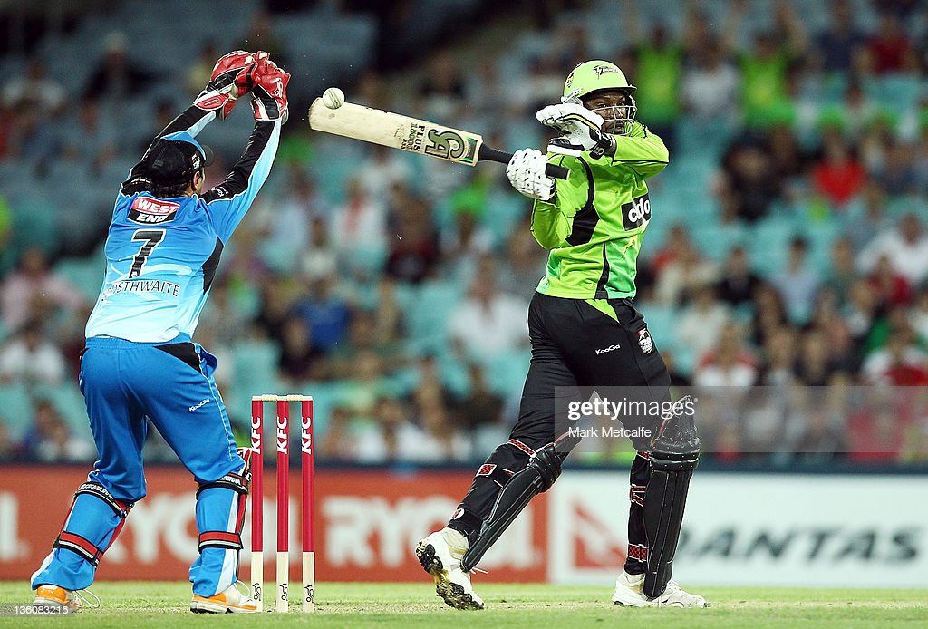 <a gi-track='captionPersonalityLinkClicked' href=/galleries/search?phrase=Chris+Gayle+-+Cricket+Player&family=editorial&specificpeople=206191 ng-click='$event.stopPropagation()'>Chris Gayle</a> of the Thunder bats during the T20 Big Bash League match between the Sydney Thunder and the Adelaide Strikers at ANZ Stadium on December 23, 2011 in Sydney, Australia.