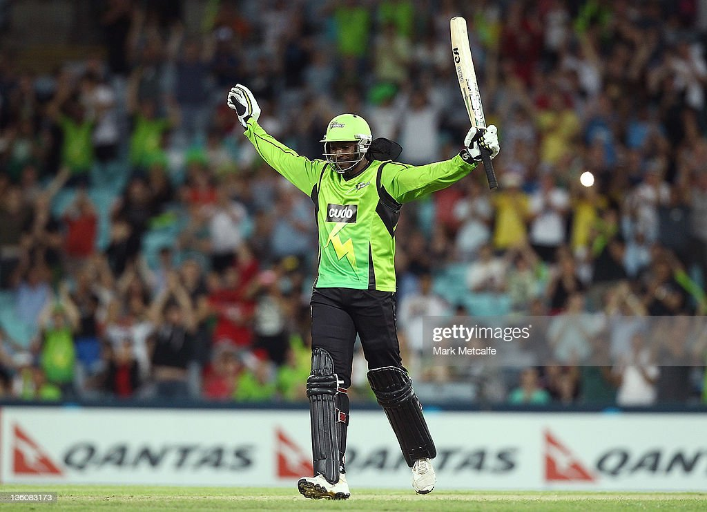 <a gi-track='captionPersonalityLinkClicked' href=/galleries/search?phrase=Chris+Gayle+-+Cricket+Player&family=editorial&specificpeople=206191 ng-click='$event.stopPropagation()'>Chris Gayle</a> of the Thunder celebrates getting a century during the T20 Big Bash League match between the Sydney Thunder and the Adelaide Strikers at ANZ Stadium on December 23, 2011 in Sydney, Australia.