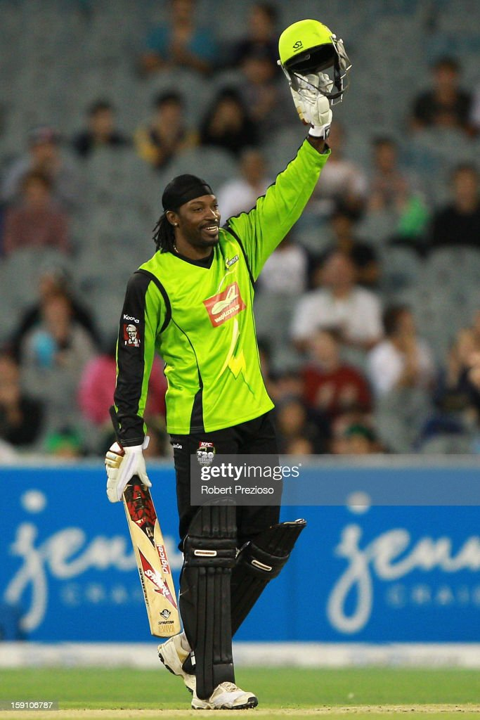 <a gi-track='captionPersonalityLinkClicked' href=/galleries/search?phrase=Chris+Gayle+-+Cricket+Player&family=editorial&specificpeople=206191 ng-click='$event.stopPropagation()'>Chris Gayle</a> of the Thunder celebrates his half century during the Big Bash League match between the Melbourne Stars and the Sydney Thunder at Melbourne Cricket Ground on January 8, 2013 in Melbourne, Australia.