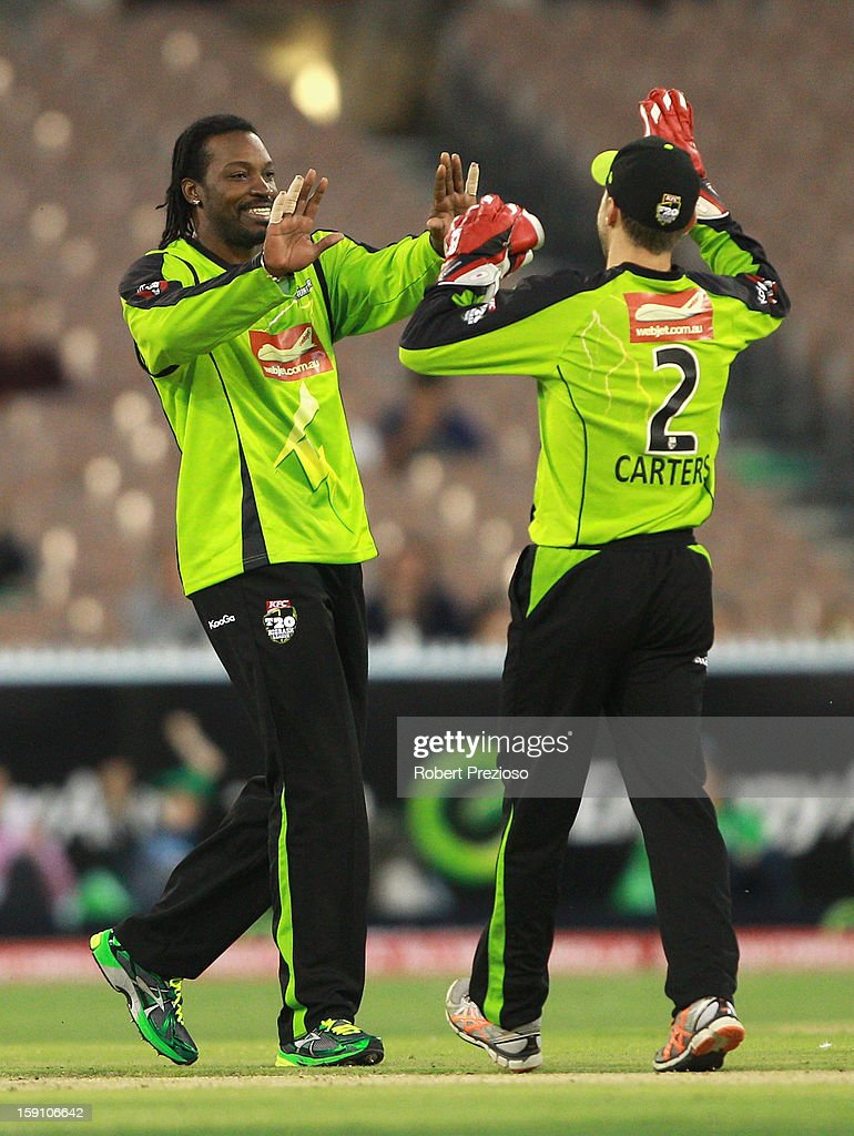 Chris Gayle of the Thunder celebrates the wicket of John Hastings of the Stars during the Big Bash League match between the Melbourne Stars and the Sydney Thunder at Melbourne Cricket Ground on January 8, 2013 in Melbourne, Australia.