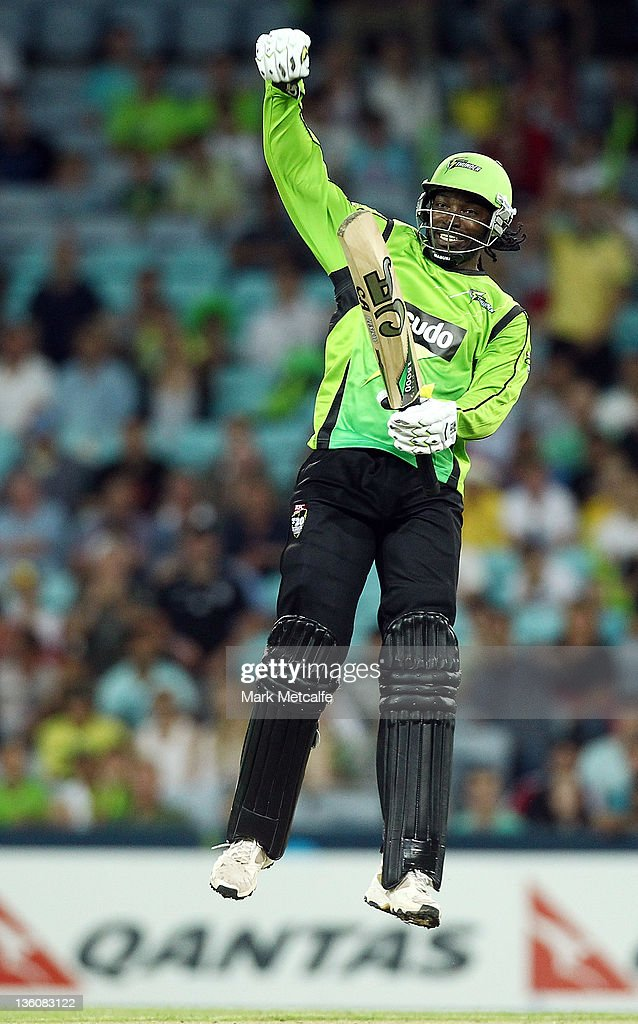 <a gi-track='captionPersonalityLinkClicked' href=/galleries/search?phrase=Chris+Gayle+-+Cricket+Player&family=editorial&specificpeople=206191 ng-click='$event.stopPropagation()'>Chris Gayle</a> of the Thunder celebrates victory during the T20 Big Bash League match between the Sydney Thunder and the Adelaide Strikers at ANZ Stadium on December 23, 2011 in Sydney, Australia.