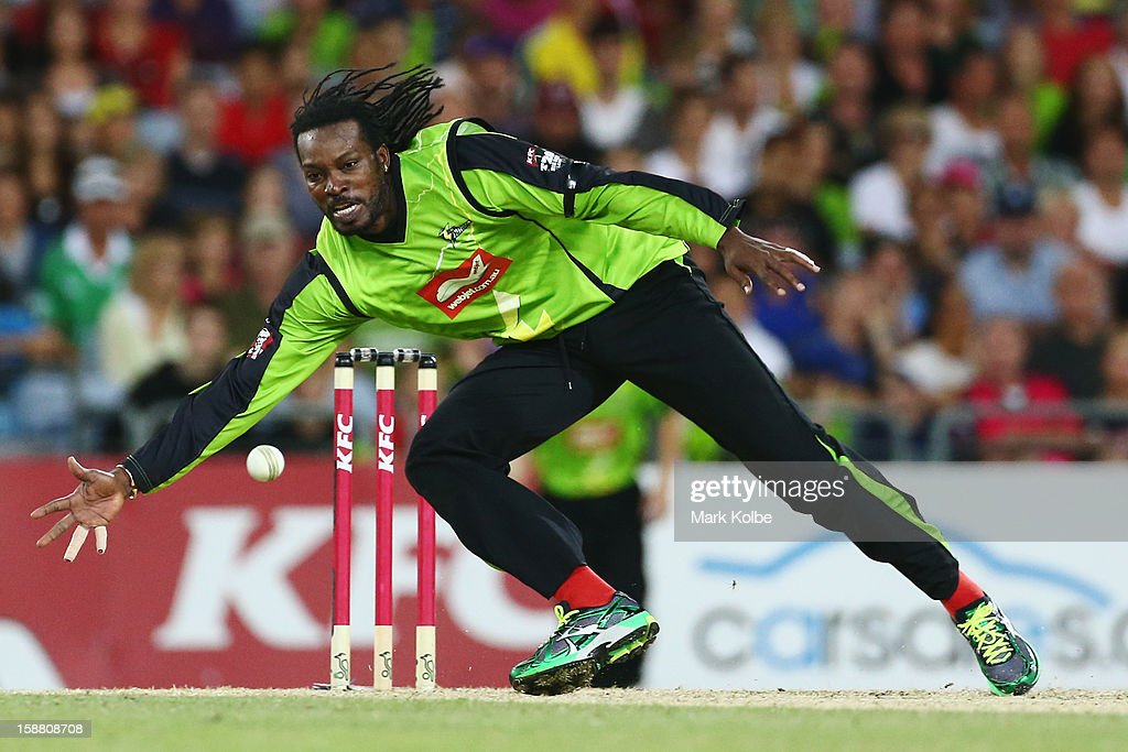<a gi-track='captionPersonalityLinkClicked' href=/galleries/search?phrase=Chris+Gayle+-+Cricket+Player&family=editorial&specificpeople=206191 ng-click='$event.stopPropagation()'>Chris Gayle</a> of the Thunder fields during the Big Bash League match between Sydney Thunder and the Sydney Sixers at ANZ Stadium on December 30, 2012 in Sydney, Australia.