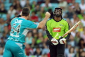 Chris Gayle of the Thunder looks dejected as he is dismissed by Dan Christian of the Heat during the Big Bash League match between the Sydney Thunder...