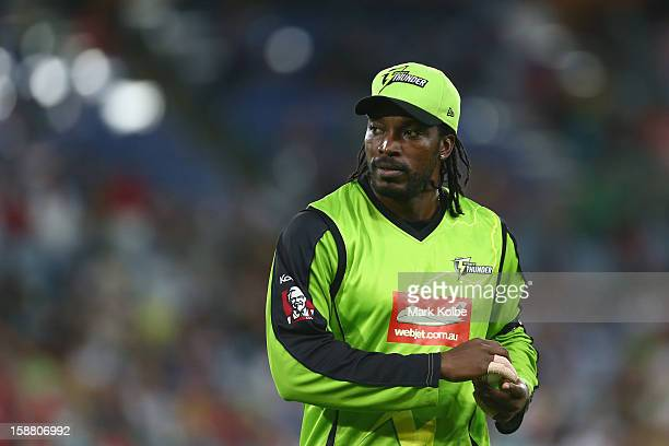Chris Gayle of the Thunder looks on during the Big Bash League match between Sydney Thunder and the Sydney Sixers at ANZ Stadium on December 30 2012...