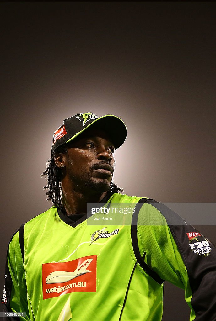 <a gi-track='captionPersonalityLinkClicked' href=/galleries/search?phrase=Chris+Gayle+-+Cricket+Player&family=editorial&specificpeople=206191 ng-click='$event.stopPropagation()'>Chris Gayle</a> of the Thunder looks on losing the Big Bash League match between the Perth Scorchers and the Sydney Thunder at WACA on January 4, 2013 in Perth, Australia.
