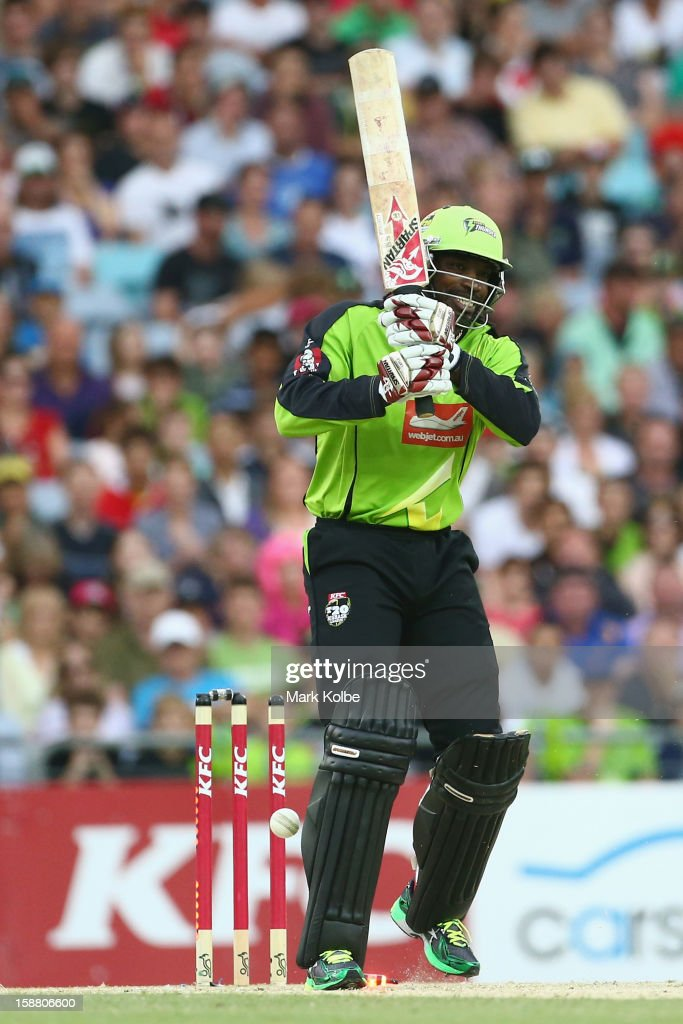 <a gi-track='captionPersonalityLinkClicked' href=/galleries/search?phrase=Chris+Gayle+-+Cricketspieler&family=editorial&specificpeople=206191 ng-click='$event.stopPropagation()'>Chris Gayle</a> of the Thunder reacts after being bowled during the Big Bash League match between Sydney Thunder and the Sydney Sixers at ANZ Stadium on December 30, 2012 in Sydney, Australia.