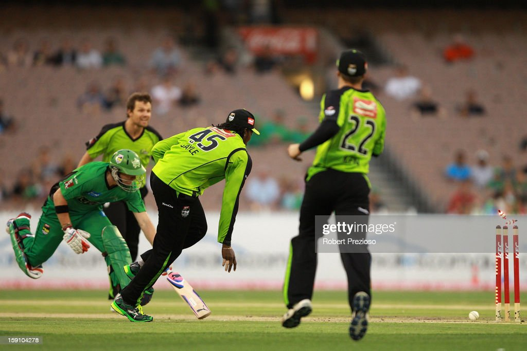 <a gi-track='captionPersonalityLinkClicked' href=/galleries/search?phrase=Chris+Gayle+-+Cricket+Player&family=editorial&specificpeople=206191 ng-click='$event.stopPropagation()'>Chris Gayle</a> of the Thunder runs out Luke Wright of the Stars during the Big Bash League match between the Melbourne Stars and the Sydney Thunder at Melbourne Cricket Ground on January 8, 2013 in Melbourne, Australia.