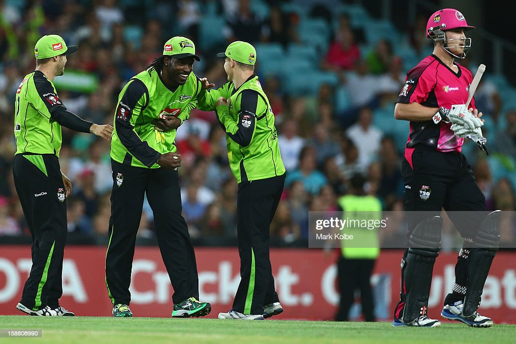 Chris Gayle of the Thunder shares a laugh with his team mates after catching Nic Maddinson of the Sixers during the Big Bash League match between Sydney Thunder and the Sydney Sixers at ANZ Stadium on December 30, 2012 in Sydney, Australia.