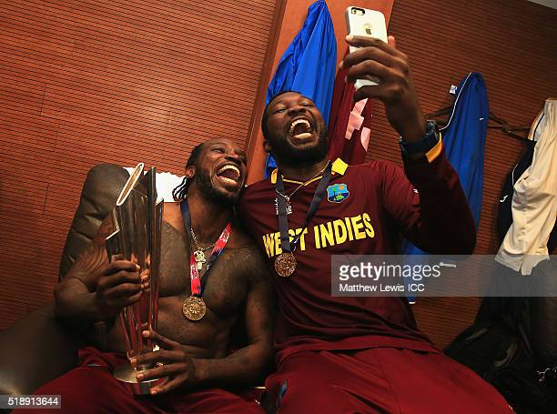 Chris Gayle of the West Indies and Sulieman Benn of the West Indies celebrate their teams win over England during the ICC World Twenty20 India 2016...