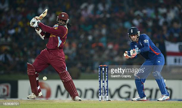 Chris Gayle of the West Indies bats watched by England wicketkeeper Craig Kieswetter during the ICC World Twenty20 2012 Super Eights Group 1 match...