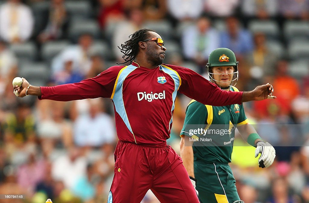 Chris Gayle of the West Indies bowls during the Commonwealth Bank One Day International Series between Australia and the West Indies at Manuka Oval on February 6, 2013 in Canberra, Australia.