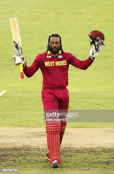 Chris Gayle of the West Indies celebrates and acknowledges the crowd after scoring a century during the 2015 ICC Cricket World Cup match between the...