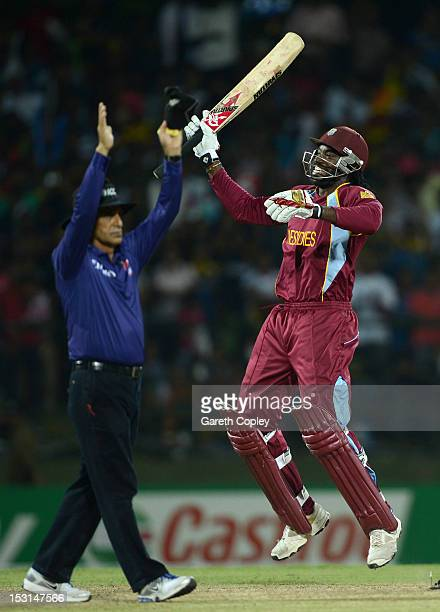 Chris Gayle of the West Indies celebrates winning the superover to win the ICC World Twenty20 2012 Super Eights Group 1 match between the West Indies...